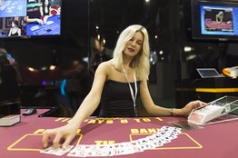 A dealer spreads a deck of cards on a baccarat table during a gambling expo in Macau on May 20. European Pressphoto Agency